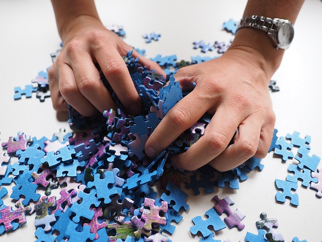 hands holding pieces of the puzzle